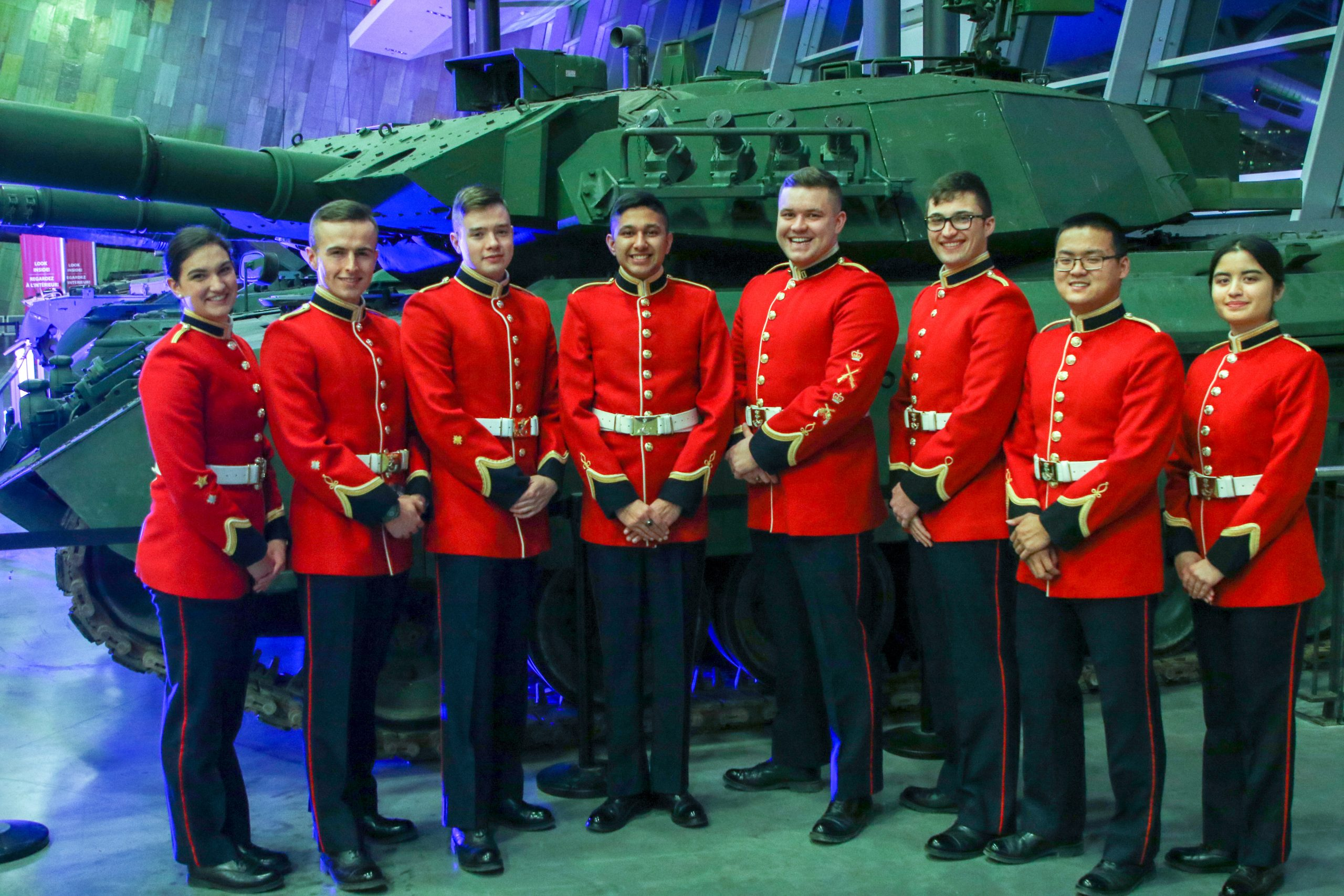RMC Debate and International Affairs Society in front of tank display